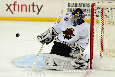 Gwinnett goalie Billy Sauer (#36) makes a save in ECHL Hockey action between South Carolina and Gwinnett.  South Carolina defeated Gwinnett 5-2 in the game at The Arena at Gwinnett in Duluth, GA.