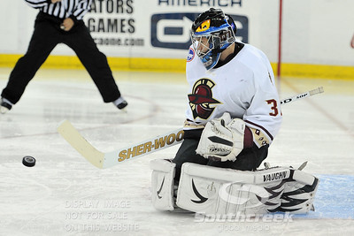 Gwinnett goalie Billy Sauer (#36) saves a goal in ECHL Hockey action between South Carolina and Gwinnett.  South Carolina defeated Gwinnett 5-2 in the game at The Arena at Gwinnett in Duluth, GA.