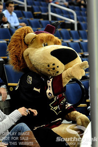 Gwinnett mascot Maximus taunts the South Carolina players from behind the glass during ECHL Hockey action between South Carolina and Gwinnett.  South Carolina defeated Gwinnett 5-2 in the game at The Arena at Gwinnett in Duluth, GA.
