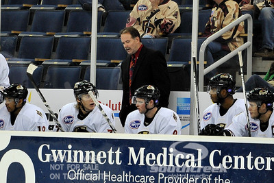 Gwinnett head coach Jeff Pyle talks to his players during ECHL Hockey action between South Carolina and Gwinnett.  South Carolina defeated Gwinnett 5-2 in the game at The Arena at Gwinnett in Duluth, GA.