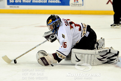 Gwinnett goalie Billy Sauer (#36) tries to corral the puck in ECHL Hockey action between South Carolina and Gwinnett.  South Carolina defeated Gwinnett 5-2 in the game at The Arena at Gwinnett in Duluth, GA.