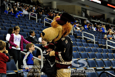 Gwinnett mascot Maximus poses with children in the crowd during ECHL Hockey action between South Carolina and Gwinnett.  South Carolina defeated Gwinnett 5-2 in the game at The Arena at Gwinnett in Duluth, GA.