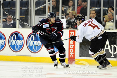 South Carolina forward David de Kastrozza (#28) shows Gwinnett defenseman Will Colbert (#4) his game face in ECHL Hockey action between South Carolina and Gwinnett.  South Carolina defeated Gwinnett 5-2 in the game at The Arena at Gwinnett in Duluth, GA.