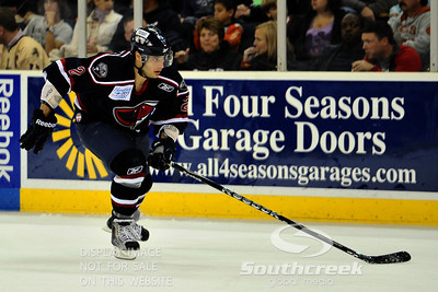 South Carolina defenseman Josh Godfrey (#2) takes off after the puck in ECHL Hockey action between South Carolina and Gwinnett.  South Carolina defeated Gwinnett 5-2 in the game at The Arena at Gwinnett in Duluth, GA.
