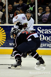 Gwinnett forward Dan Kissel (#11) has his eye on the puck in ECHL Hockey action between South Carolina and Gwinnett.  South Carolina defeated Gwinnett 5-2 in the game at The Arena at Gwinnett in Duluth, GA.