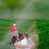 Skyline's Gina Larson hits out of a sand trap during the 5A State Golf Championships at Common Ground Golf Course in Denver, Colorado May 25, 2010.  CAMERA/Mark Leffingwell