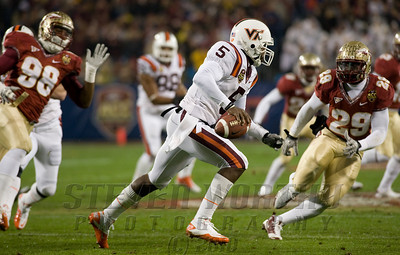 VA Tech's Tyrod Taylor (5) looks to pass against the Florida State defense.