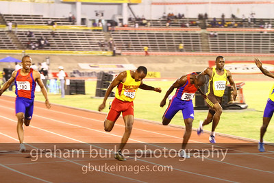 Wolmers' Boys Class 1 champion, Juilian Forte dipping to the line in 10.4s to win the 100M.