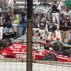 Fifth-place finisher Scott Dixon passes by Dan Wheldon on his way to the pits after the race.