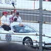 Chip Ganassi and Dario Franchitti take a victory lap in the pace car.  Ashley Judd is also in the car, behind Ganassi.