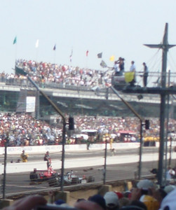 Dario Franchitti takes the checkered flag, under a caution, with Dan Wheldon behind.