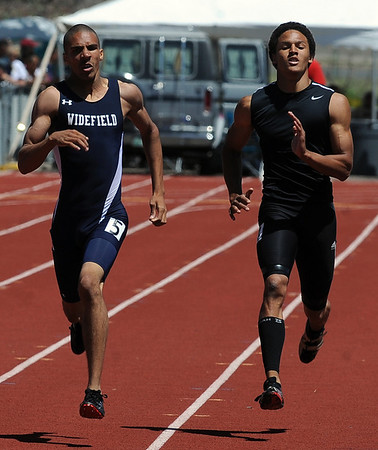 Trent Wright, right,  of Silver Creek finished second in the 400 meters. Boris Berian of Widefield won the race.<br /> Cliff Grassmick / May 22, 2010