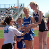 Melody Fairchild, left, former great from Boulder High, presents Kelley Robinson  of Nederland with the second place medal for the 1600 meters.<br /> Cliff Grassmick / May 22, 2010
