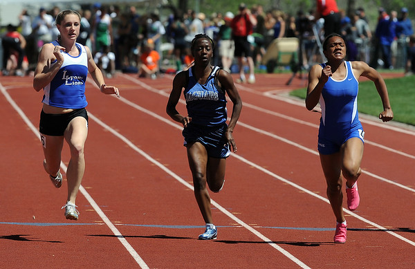 Khadijah Sayyid, right, of Peak to Peak wins the 3A 100 meters, just edging out Rachel Hinker, left, of Lyons. Icenia Anderson, center, was third.<br /> Cliff Grassmick / May 22, 2010