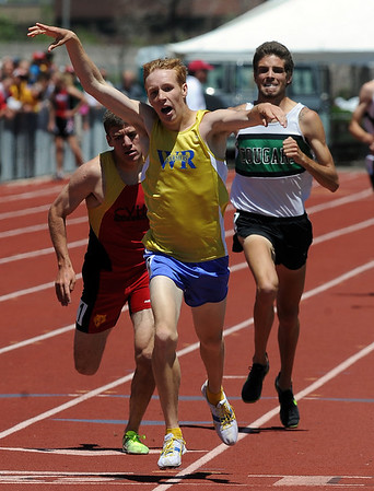 Scott Fauble of Wheat Ridge, wins the 1600 meters, David Perry, right,  of Niwot was third.<br /> Cliff Grassmick / May 22, 2010
