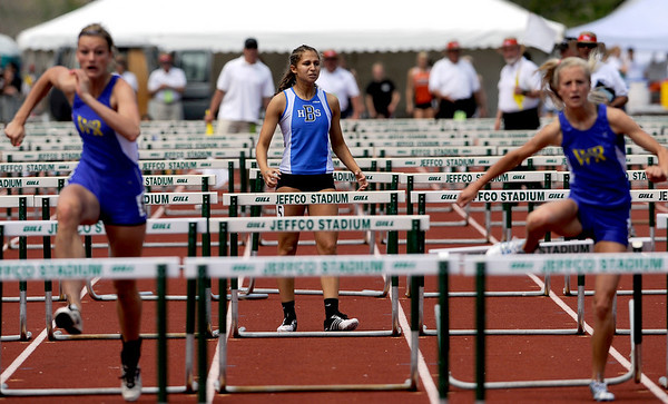 Broomfield's Kayla Wein stops in frustration after getting bumped in the Women's 4A 100 meter hurdles during the State Track Championships at Jefferson County Stadium in Lakewood, Colorado May 21, 2010.  CAMERA/Mark Leffingwell