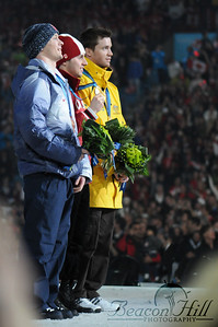 The Men's Moguls champions pose at the Vancouver Victory Ceremony on February 15, 2010.