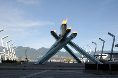 The Olympic Cauldron during the day. It's nice and crowd-free due to an ugly chain link fence, although during the course of the games it was in turn moved closer to the flame, had a gap cut into it, and had the lower section replaced with clear plexiglass.