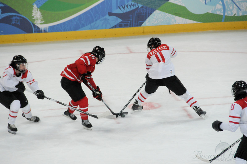 The Canadian women take on the Swiss during a preliminary hockey game.