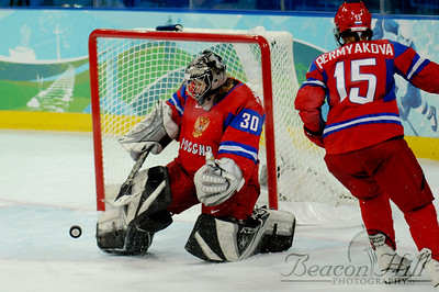 The Russian goalie deflects a US shot.