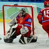 The Russian goalie deflects a US shot.