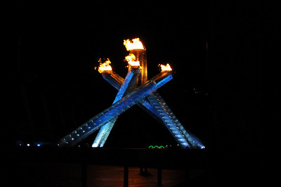 The Olympic Cauldron lit by Wayne Gretzky. The three green loops in the background are the top of the green Olympic Rings which overlooked the water.
