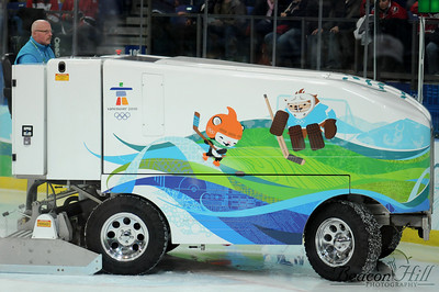 The Zambonis used at the Olympics were actually not Zambonis but rather a different brand of ice-shaping machine which ran entirely on batteries, and were obviously decorated nicely for the Olympics. Although I wasn't there to see it, apparently one of these machines broke down at the Richmond Olympic Oval, delaying the competition and necessitating a brand-name Zamboni be shipped in from Calgary during the course of the games.
