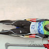 A German luge athlete works his way around a curve on the track.