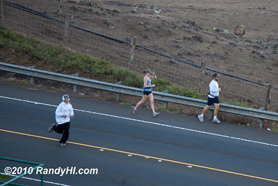IMG_3112 I do not know who the boy in the hoody and earmuffs was but he must have surprised the participants as he passed them running down the centerline of the Kula Highway!