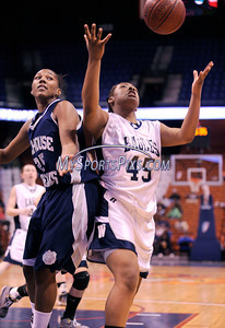 3/20/2010 Mike Orazzi | Staff Wethersfield's Morgan Murphy (45) and Hillhouse Ta'kerra Williams (25) during the Class L State Girls Basketball Championship game with Hillhouse High School on Saturday at the Mohegan Sun Arena on Saturday, March 20, 2010.