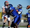 10/9/2010 Mike Orazzi | Staff<br /> CCSU's Chris Linares (16) and Isaiah Boddie (13) break up a pass in the end zone intended for Duquesne's Connor Dixon (10) during Saturday's homecoming football game.