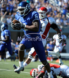 10/9/2010 Mike Orazzi | Staff CCSU's Josue Paul (5) and Duquesne's Devin Duggan (21) and Marcus Hughes (45) a long TD pass for Paul during Saturday's homecoming football game.