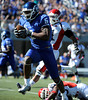 10/9/2010 Mike Orazzi | Staff<br /> CCSU's Josue Paul (5) and Duquesne's Devin Duggan (21) and Marcus Hughes (45) a long TD pass for Paul during Saturday's homecoming football game.