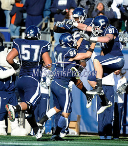 11/27/2010 Mike Orazzi | Staff UConn's Jordan Todman (23) celebrates a TD late in the second quarter with Ryan Griffin (94) and Corey Manning (81) during a 38-17 UConn win on November 27, 2010 at Rentschler Field in East Hartford, Connecticut.