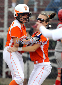 6/12/2010 Mike Orazzi | Staff Terryville's Jamie Bridge (6) and Brenda Carobini (1) celebrate after Bridge scored the first run of the game during the Class S State Softball Final at DeLuca Field in Stratford, Conn. on Saturday, June 12, 2010. Terryville went on to win 2-0.