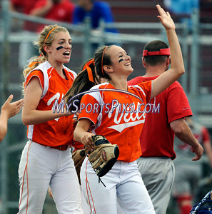 6/12/2010 Mike Orazzi | Staff Terryville's Marissa Plikus (5)and Beth Grimes celebrate the end of an inning during the Class S State Softball Final at DeLuca Field in Stratford, Conn. on Saturday, June 12, 2010. Terryville went on to win 2-0.