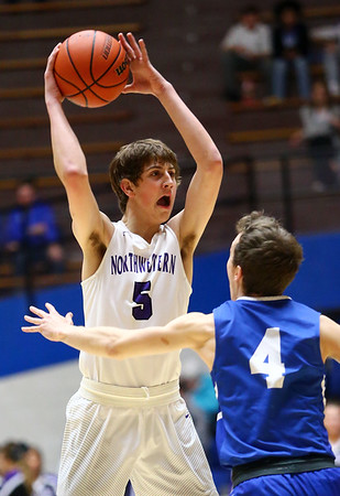 2-27-18<br /> Northwestern vs Frankfort boys basketball<br /> NW's Ben Harris looks to throw a pass.<br /> Kelly Lafferty Gerber | Kokomo Tribune