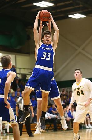 2-6-18<br /> Eastern vs Tipton boys basketball<br /> Tipton's Trent Seward grabs a rebound.<br /> Kelly Lafferty Gerber | Kokomo Tribune