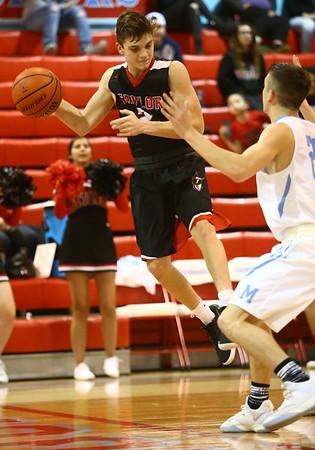 2-20-18<br /> Maconaquah vs Taylor boys basketball<br /> Taylor's Wynn Takacs throws a pass that bounces off a Mac player's shoe.<br /> Kelly Lafferty Gerber | Kokomo Tribune