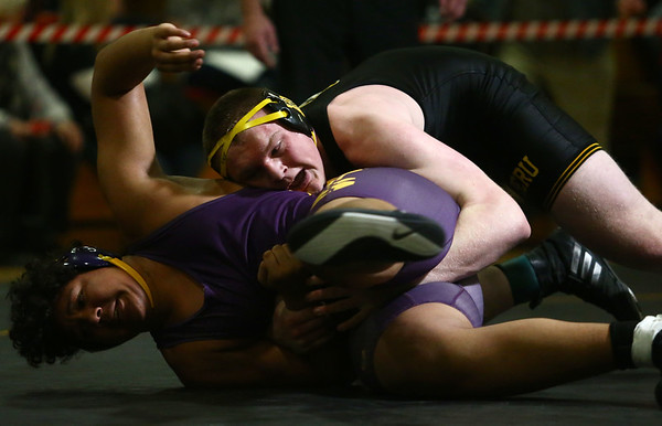 2-3-18<br /> Regional wrestling<br /> Peru's Avery Jones is beaten by Marion's Gabe Watkins in the 285.<br /> Kelly Lafferty Gerber | Kokomo Tribune