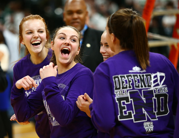 2-24-18<br /> Northwestern wins the 3A state championship against Greensburg 63-42. Katie Neher, center, and Klair Merrell, left, celebrate with teammates after the win.<br /> Kelly Lafferty Gerber | Kokomo Tribune