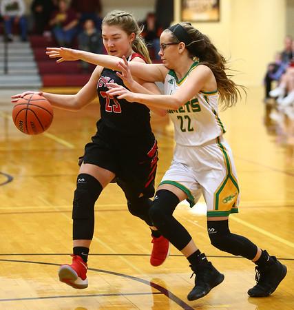 2-2-18<br /> Eastern vs Taylor girls sectional semifinal<br /> Eastern's Lexi James plays defense on Taylor's Ashlen Kropczynski as she nears the basket.<br /> Kelly Lafferty Gerber | Kokomo Tribune