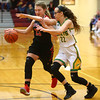 2-2-18<br /> Eastern vs Taylor girls sectional semifinal<br /> Eastern's Lexi James plays defense on Taylor's Ashlen Kropczynski as she nears the basket.<br /> Kelly Lafferty Gerber | Kokomo Tribune