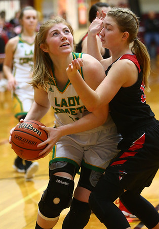 2-2-18<br /> Eastern vs Taylor girls sectional semifinal<br /> Eastern's Hailey Holliday looks to the basket for a shot.<br /> Kelly Lafferty Gerber | Kokomo Tribune