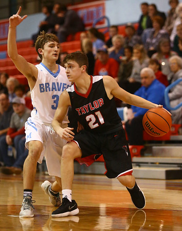 2-20-18<br /> Maconaquah vs Taylor boys basketball<br /> Wynn Takacs looks to dribble around Mac's Chandler Pitts.<br /> Kelly Lafferty Gerber   Kokomo Tribune