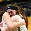 2-24-18<br /> Northwestern wins the 3A state championship against Greensburg 63-42. Stephanie Burns hugs her teammate after the Northwestern win.<br /> Kelly Lafferty Gerber | Kokomo Tribune