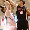 2-20-18<br /> Maconaquah vs Taylor boys basketball<br /> Mac's Bryce Ward shoots as Taylor's Wynn Takacs tries to block.<br /> Kelly Lafferty Gerber | Kokomo Tribune