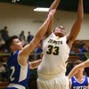 2-6-18<br /> Eastern vs Tipton boys basketball<br /> Eastern's Antonio Matthews grabs a rebound.<br /> Kelly Lafferty Gerber | Kokomo Tribune