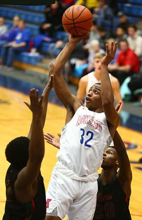 2-1-18<br /> Kokomo vs Arsenal Tech boys basketball<br /> Deonta Chamberlain shoots.<br /> Kelly Lafferty Gerber | Kokomo Tribune