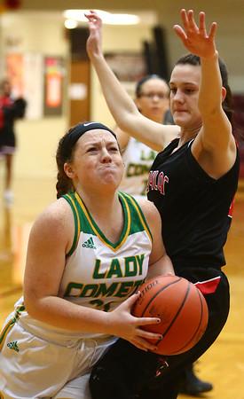 2-2-18<br /> Eastern vs Taylor girls sectional semifinal<br /> Eastern's Maci Weeks looks to the basket for a shot.<br /> Kelly Lafferty Gerber | Kokomo Tribune